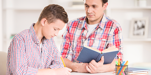 Father-helping-teen-son-study-at-home