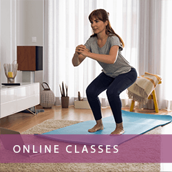 woman exercising in front of computer