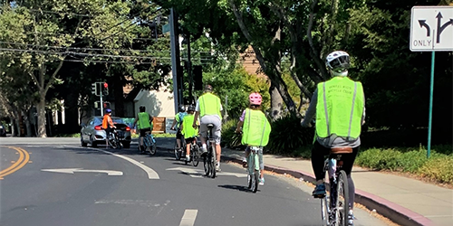2 - Blog-post--group-on-bicycles-approaching-intersection