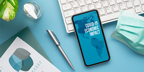 Blog-post--COVID-19-economic-impact-message-on-cellphone-screen